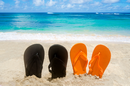 flops: Ocean Halloween background with and flip flops Stock Photo