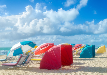 Colorful Beach umbrellasparasols and cabanas at empty morning Miami beach Stock Photo