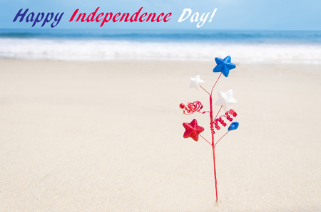 Independence Day USA background on the sandy beach near the ocean American Patriotic comcept Stock Photo