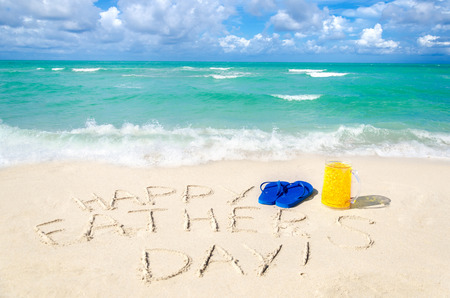 Happy father's day background with flip flops and beer on the Miami beach near the ocean, Florida Stock Photo