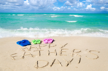 Happy father's day background with flip flops on the Miami sandy beach near the ocean, Florida