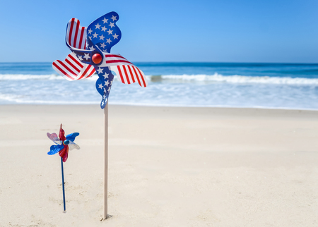 Patriotic USA background with decorations on the sandy beach Stock Photo