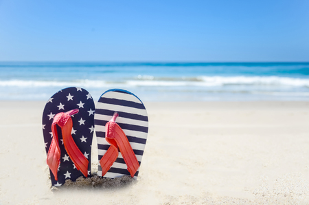 slippers: Patriotic USA background with flip flops and decorations on the sandy beach