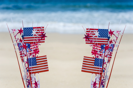 Patriotic USA background with flags and decorations on the sandy beach Stock fotó - 78984446