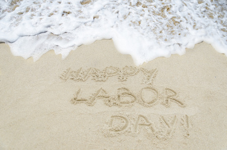 Labor day background on the sandy beach near ocean