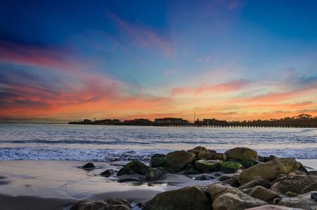 Santa Barbara tropical beach sunset near pier, piece and harmony concept  Stock Photo