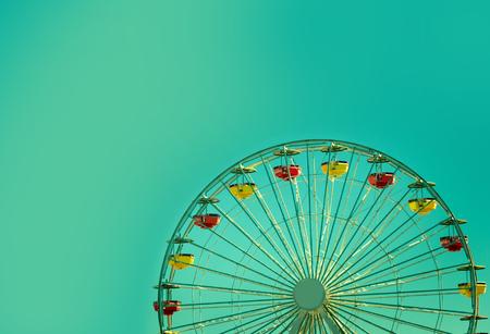 Ferris Wheel Over Sky Background, retro toning