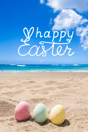 Happy easter background with color eggs on the ocean beach. Hand drawn Happy Easter typography lettering poster.