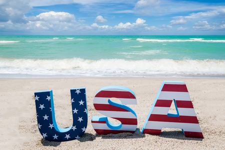 Patriotic USA with decorations on the sandy beach