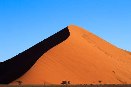 Red dunes on the road to Sossusvlei, Namibia photo