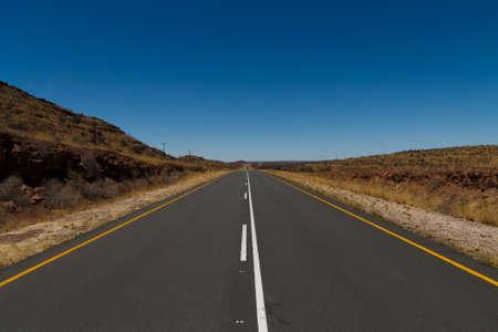 kalahari desert: Tarmac road from Mariental to Kalahari desert Stock Photo