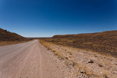 kalahari: Dirt road out of Mata Mata gate to Kalahari desert Stock Photo