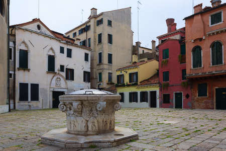 oration: A view from Venice little square with colorful houses Italy