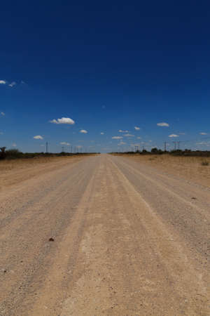 kalahari desert: Dirt road out of Mata Mata gate to Kalahari desert Stock Photo