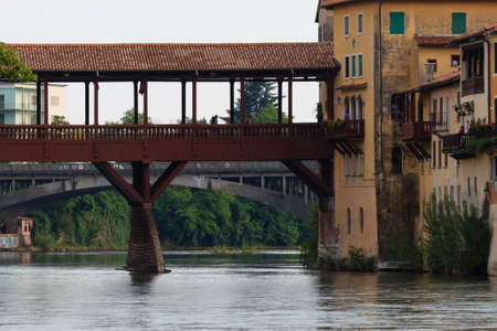grappa: Panorama from Bassano del Grappa, old wooden bridge over Brenta river, italian landscape