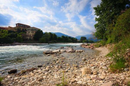 grappa: Brenta river flowing, Bassano del Grappa panorama, Italy Stock Photo
