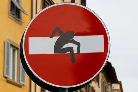 trepassing: No entry sign with a man that come out from signal, steet art, metropolitan