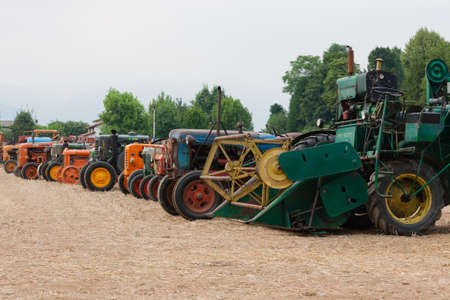 old tractors: Detail of old tractors in perspective, agricultural vehicle, rural life Stock Photo