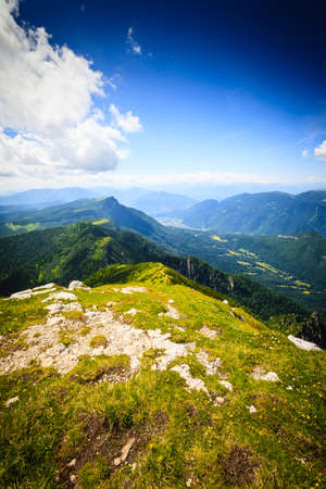 scrub grass: Panorama from Italian alps, top of a mountain, image digitally altered Stock Photo