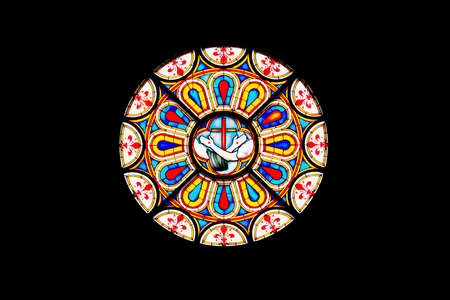 colored window: Close up of a colored rose window from a Florence church, Italy