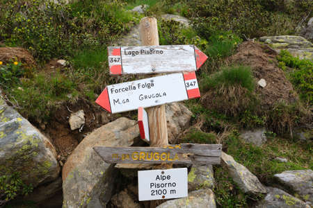 Close up of a signboard along a trekking path. Direction indication. Arrow. Hiking