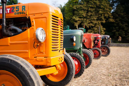 Five old tractors in perspective, agricultural vehicle, rural life