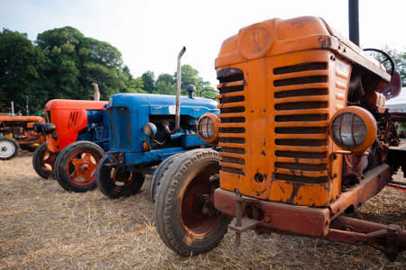 old tractors: Old tractors in perspective, agricultural vehicle, rural life Stock Photo
