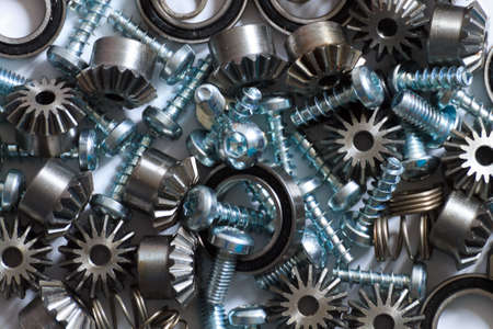 worm gear: A background with different mechanical components, gears, springs, screws, industrial objects Stock Photo