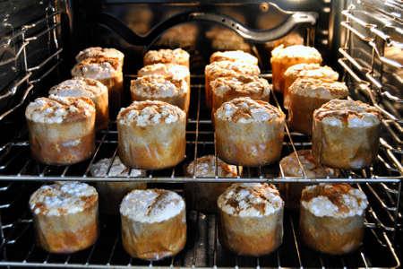 mini oven: Christmas mini panettoni inside a oven. Homemade confectionery. Food, dessert