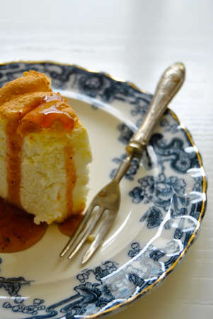 custard flavor: Close up of a slice of angel cake over a plate, homemade dessert. Food