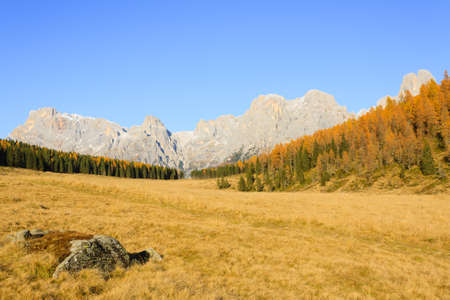red mountain open space: Autumn landscape from italian Alps. Yellow trees. Beautiful dolomites view Stock Photo