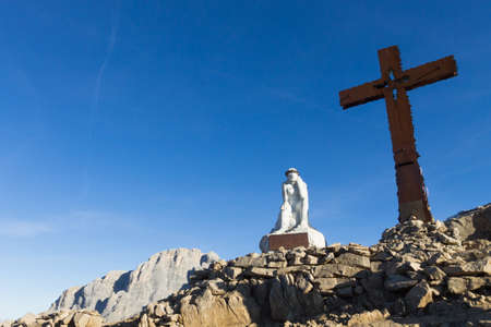 martino: Monument at the end of the trekking Del Cristo Pensante from San Martino di Castrozza, Italian Alps. Christian cross Stock Photo
