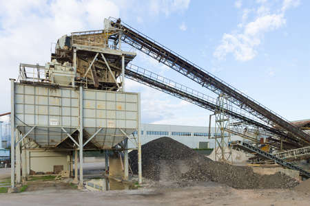 conveyor belts: Stone quarry with silos and conveyor belts. Industrial equipment. Mining