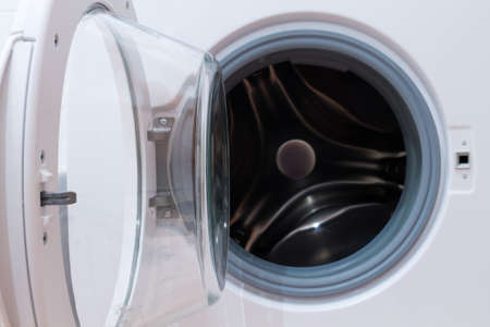 launder: Detail of a open washing machine with depth of field. Household appliance