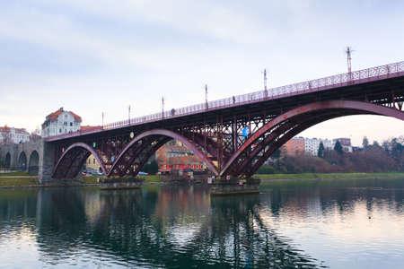 slovenian: Beautiful slovenian landscape. Maribor old bridge. Urban panorama. Stock Photo