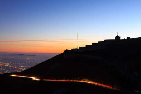 grappa: Night view from Monte Grappa first world war memorial. Italian Alps. Light trails with building in silhouette