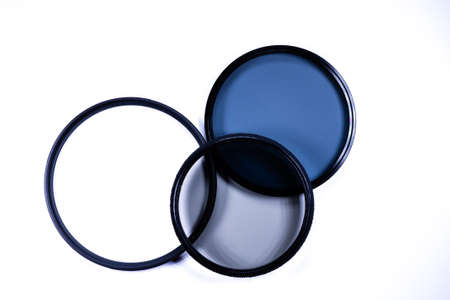Photographic camera equipment lens filter on white background