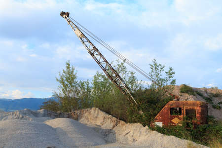 decadence: Quarry crane out of service. Industrial machinery. Mining Stock Photo