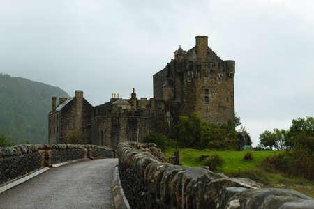 the jacobite: View of Eilean Donan Castle from Scotland. Ancient medieval castle. Scottish landscape