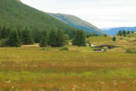 highlands region: Rural panorama from Scotland. Grenn hills from Highlands region. Travel destinations Stock Photo