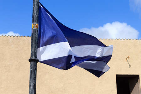 the jacobite: Scottish flag waving in the wind