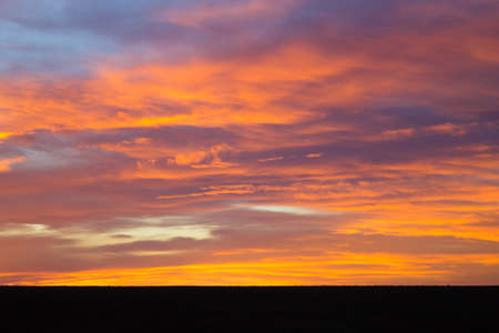 open space: Sunset from Addo Elephant National Park, South Africa. Dramatic sky. Open space landscape Stock Photo