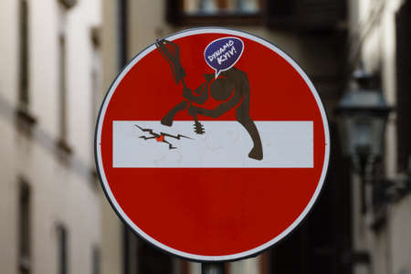trepassing: No entry sign with a man that broke a guitar, steet art, metropolitan Editorial