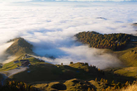Panorama from Italian alps, carpet of clouds and peaks. Top mountain landscape Stock Photo