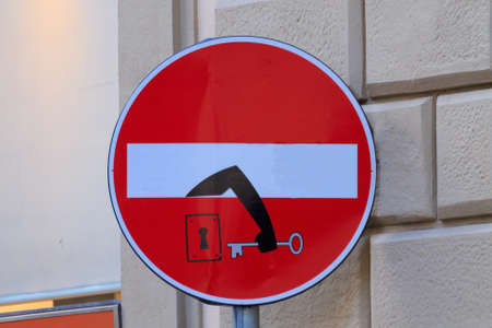 trepassing: Road sign with an arm that comes out from signal, street art, metropolitan art Stock Photo