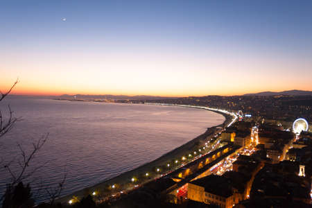 maritimes: Nice beach night landscape, France.  Nice beach and famous Walkway of the English, Promenade des Anglais. Famous French touristic town Stock Photo