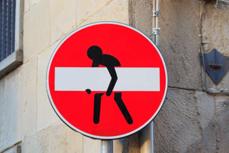 trepassing: Road sign with a man that stole the signal, street art, metropolitan art