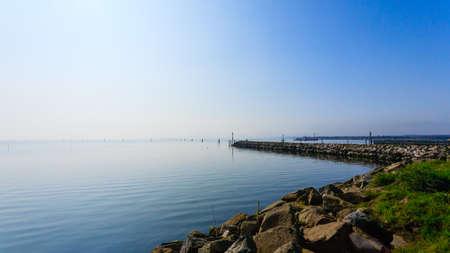 groynes: Breakwater on adriatic sea. Goro port view. Po Delta wetlands landmark. Italian travel destination Stock Photo