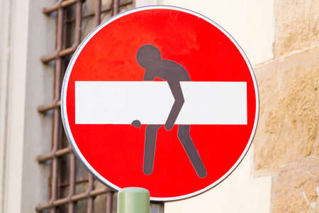 trepassing: Road sign with a man that stole the signal, steet art, metropolitan Stock Photo