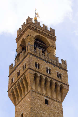 Old Palace bell tower detail view, Florence, Italian panorama. Palazzo vecchio bell tower Editorial